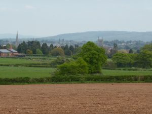 View of central Hereford over the arable fields, hay meadows, pastures and woods of rural Breinton. (N. Geeson)